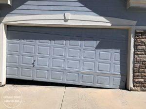 broken garage door - Garage Door Service Inc